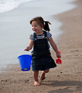 Little girl with bucket and spade