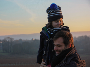 Image: Family fun - child sat on Dad's shoulders outdoors