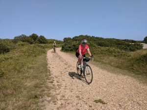 Philippa cycling in Dungeness in June 2020
